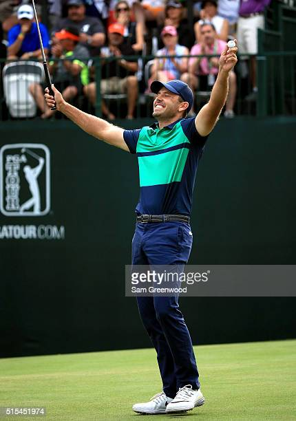 Charl Schwartzel of South Africa reacts after a putt on the first playoff hole on the 18th green to win the Valspar Championship during the final...