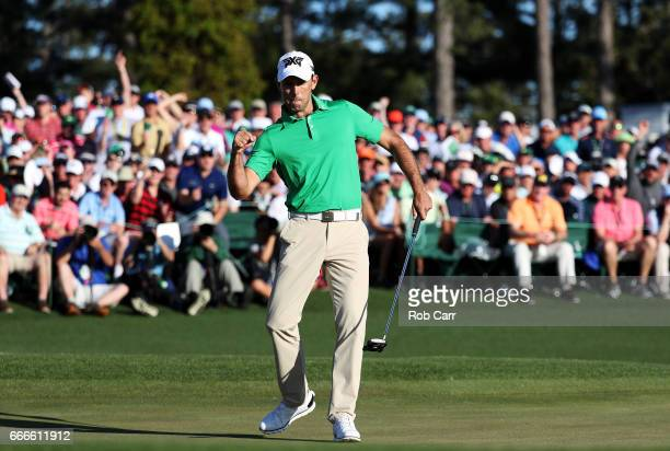 Charl Schwartzel of South Africa reacts to a putt for birdie on the 18th hole during the final round of the 2017 Masters Tournament at Augusta...