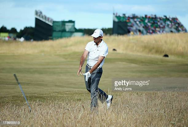 Charl Schwartzel of South Africa throws his club in reaction to a shot on the 15th hole during the first round of the 142nd Open Championship at...