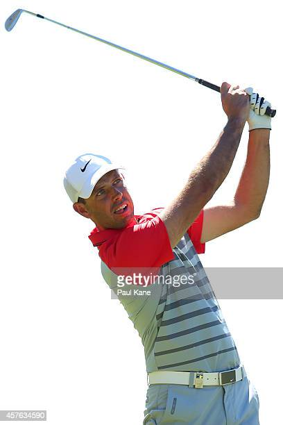 Charl Schwartzel of South Africa watches his approach shot on the 18th hole during the 2014 Perth International ProAm at Lake Karrinyup Country Club...