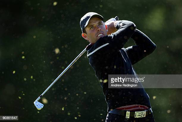 Charl Schwartzel of South Africa watches his teeshot on the 16th hole during the third round of The Omega European Masters at CransSurSierre Golf...