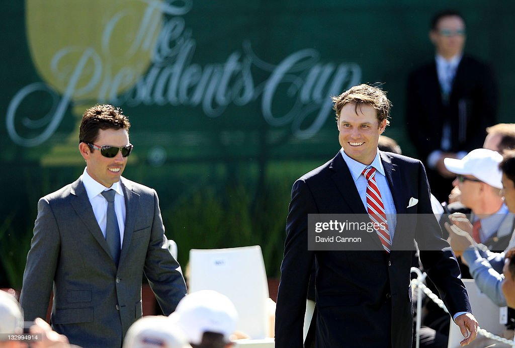 Charl Schwartzel of the International Team and Nick Watney of the U.S. Team are introduced during the Opening Ceremony prior to the start of the 2011 Presidents Cup at Royal Melbourne Golf Course on November 16, 2011 in Melbourne, Australia.