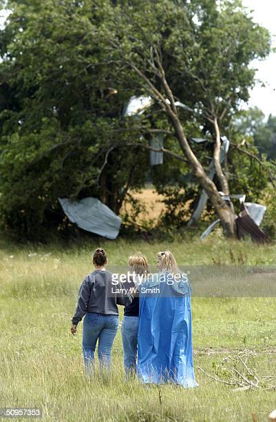Charla Lambrecht walks across her pasture with her daughter Michelle Brown and sister Janet Hansen on June 13 2004 near Mulvane Kansas A tornado hit...
