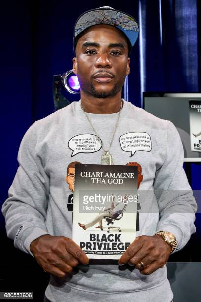 Charlamagne Tha God cohost of The Breakfast Club on New York's Power 1051autographs copies of Black Privilege Opportunity Comes to Those Who Create...