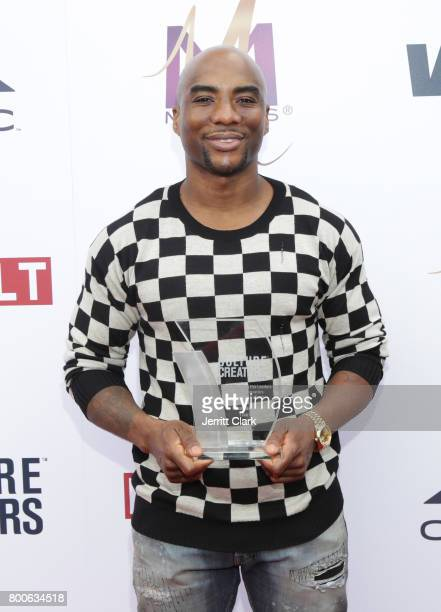 Charlamagne tha God poses with his award at Culture Creators 2nd Annual Awards Brunch Presented By Motions Hair And Ciroc at Mr C Beverly Hills on...