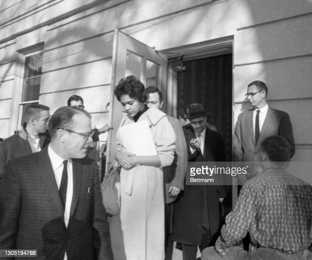 Charlayne Hunter, the first African American woman admitted to the University of Georgia, leaves the Registrar's Office on campus after being...
