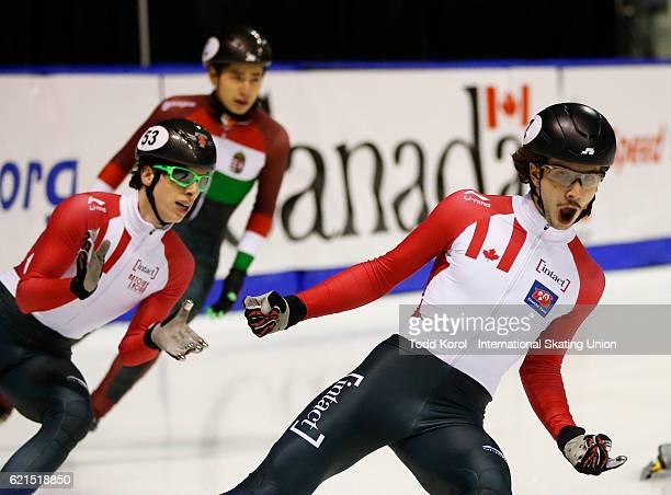 Charle Cournoyer celebrates his first place finish with teammate Samuel Girard of Canada who finished second in the men's 1000 meter final during the...