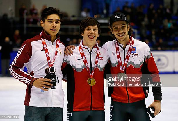 Charle Cournoyer of Canada celebrates his first place finish with teammate Samuel Girard who finished second and Shaoang Liu of Hungary who finished...