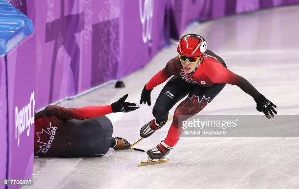 Charle Cournoyer of Canada continues after teammate Samuel Girard of Canada crashes during the Men's 5000m Relay Short Track Speed Skating heat 1 on...