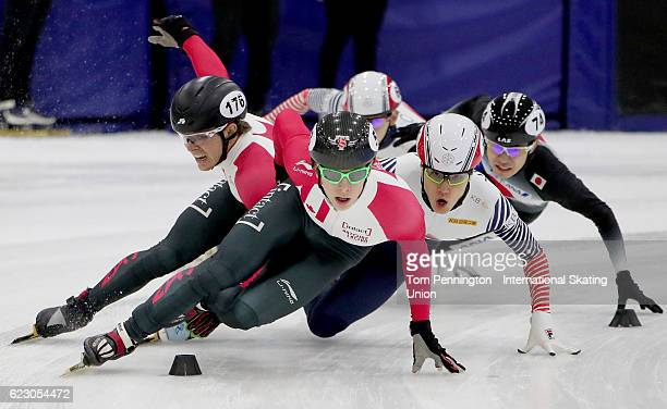 Charle Cournoyer of Canada leads the field as Pascal Dion of Canada and Seungsoo Han of Korea collide in the Men's 1500 meter Semifinal during the...