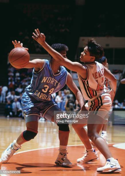 Charleata Beale, Forward for the University of Virginia Cavaliers attempts to block Tonya Sampson of the University of North Carolina Tar Heels...
