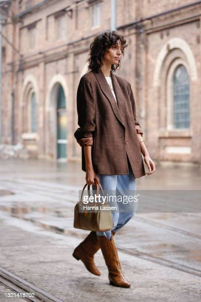 Charlee Fraser wearing all sustainable and upcycled outfit, YSL bag, vintage jeans and boots from St Vinnies shop at Afterpay Australian Fashion Week...