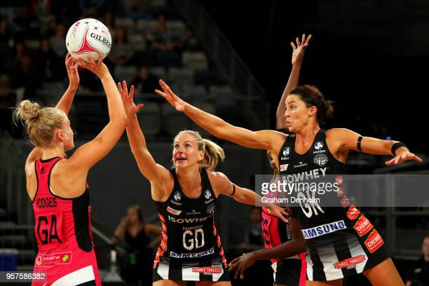 Charlee Hodges of the Thunderbirds shoots under pressure from April Brandley and Sharni Layton of the Magpies during the round three Super Netball...