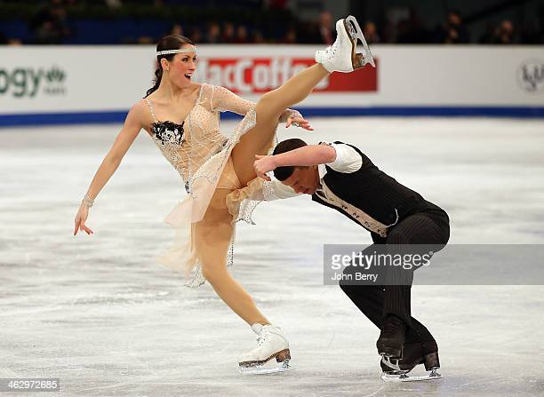 Charlene Guignard and Marco Fabbri of Italy compete in the Ice Dance Short Dance event of the ISU European Figure Skating Championships 2014 held at...