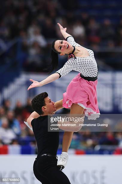 Charlene Guignard and Marco Fabbri of Italy compete in the Ice Dance Short Dance during day 2 of the European Figure Skating Championships at...