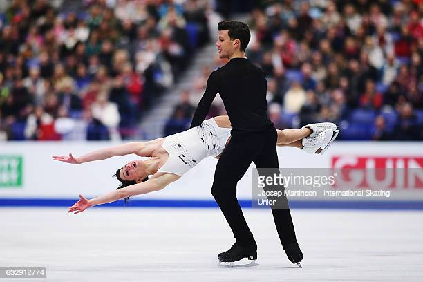 Charlene Guignard and Marco Fabbri of Italy compete in the Ice Dance Free Dance during day 4 of the European Figure Skating Championships at Ostravar...