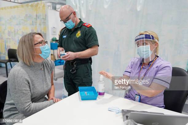 Charlene Macdonald from Washington is briefed by a member of the medical staff before receiving her AstraZeneca/Oxford University Covid-19 Vaccine at...