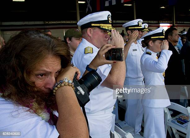 Charlene MirandaWood left holds back tears during the rifle salute as she remembers her father Vic Miranda a Pearl Harbor survivor who passed away...