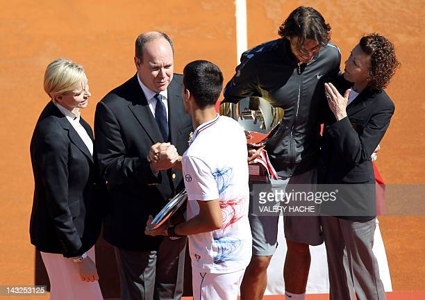Charlene of Monaco and Prince's Albert II of Monaco congratulate Novak Djokovic of Serbia as Rafael Nadal of Spain talks with Elisabeth-Anne de Massy...
