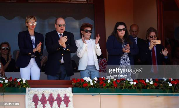 Charlene Princess of Monaco and Albert II Prince of Monaco clap during day eight of ATP Masters Series Monte Carlo Rolex Masters at MonteCarlo...