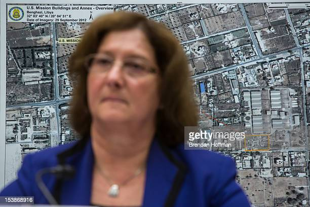 Charlene R Lamb Deputy Assistant Secretary for International Programs at the US Department of State testifies on Capitol Hill as a map of the US...