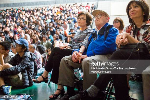"""Charlene Stern and her dad Ben Stern hold hands during the screening of """"Near Normal Man"""" at Homestead High School in Cupertino, Calif., on May 24,..."""