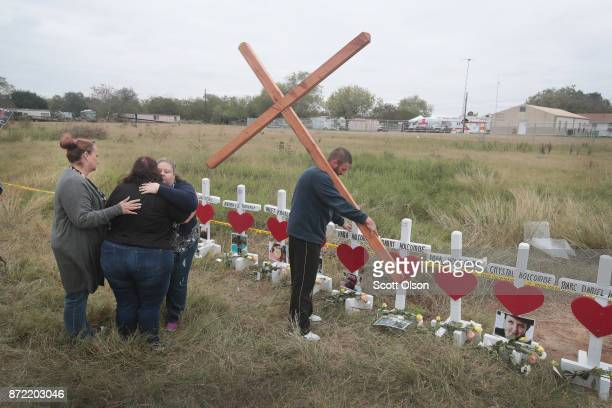 Charlene Uhl is comforted after she breaks into tears while viewing a cross with the name and picture of her 16yearold daughter Haley Krueger at a...