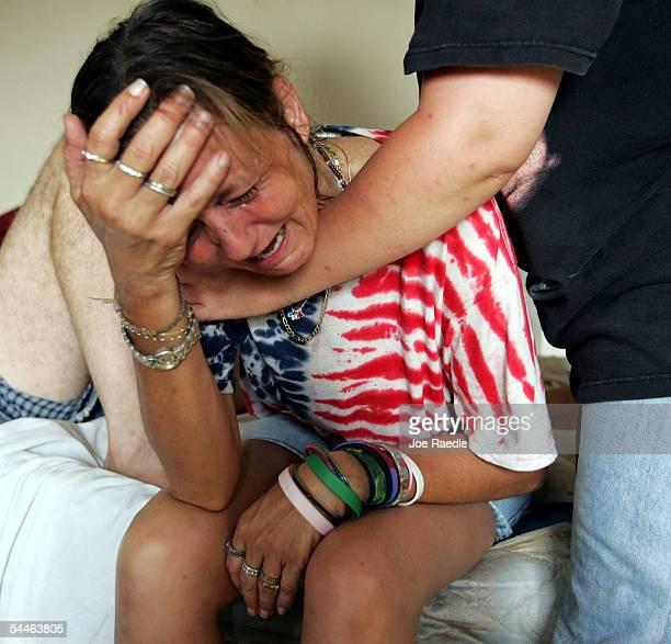 Charlene Veillon is comforted after learning her daughter Joanna Ellis was killed during Hurricane Katrina September 3 2005 in Waveland Mississippi...