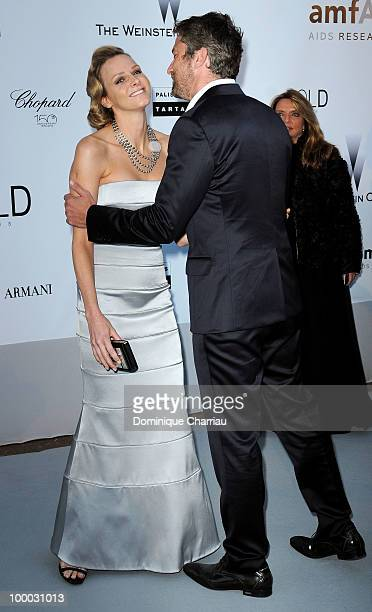Charlene Wittstock and Gerard Butler arrive at amfAR's Cinema Against AIDS 2010 benefit gala at the Hotel du Cap on May 20 2010 in Antibes France