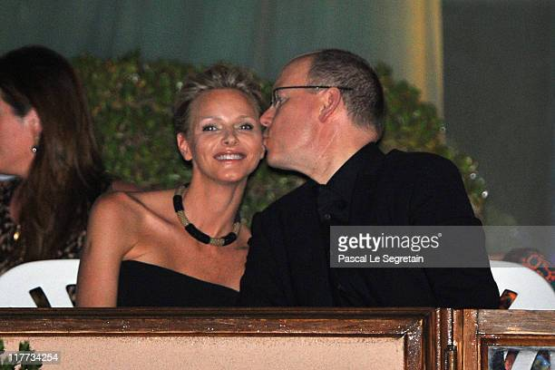Charlene Wittstock and Prince Albert II of Monaco kiss prior a concert by The Eagles at Louis II Stadium to celebrate the Royal Wedding of Prince...