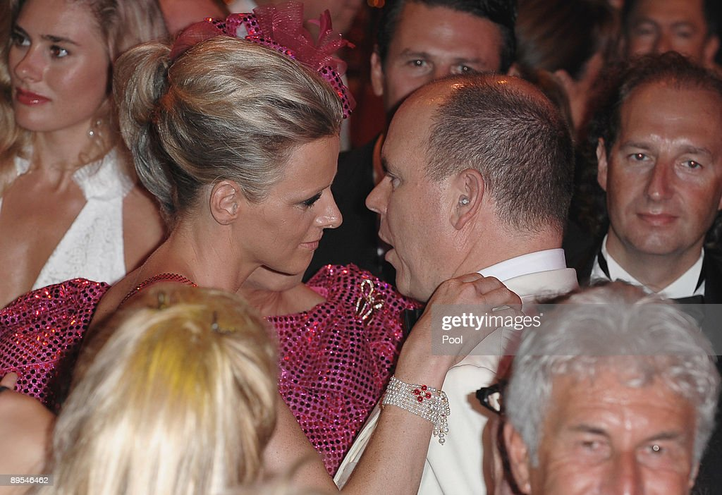 Charlene Wittstock and Prince Albert II of Monaco talk on the dancefloor as they attend the 61st Monaco Red Cross Ball at the Monte Carlo Sporting Club on July 31, 2009 in Monte Carlo, Monaco.