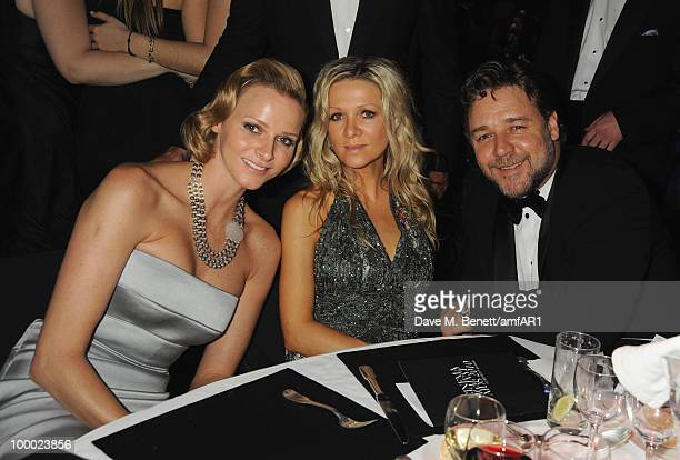 Charlene Wittstock, Danielle Spencer, and Russell Crowe attend amfAR's Cinema Against AIDS 2010 benefit gala dinner at the Hotel du Cap on May 20,...