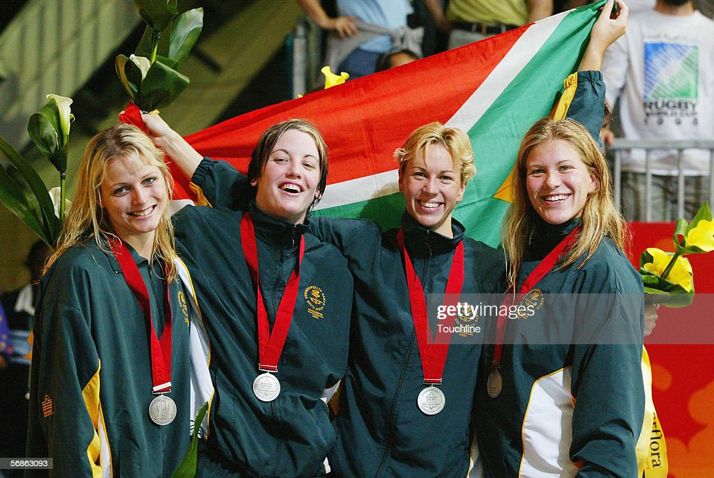 Charlene Wittstock, Sarah Poewe, Mandy Loots and Helene Muller of South Africa win the silver medal in the Women's 4x100 Medley Final at the Manchester Aquatics centre during the 2002 Commonwealth Games on August 4, 2002 in Manchester, England.