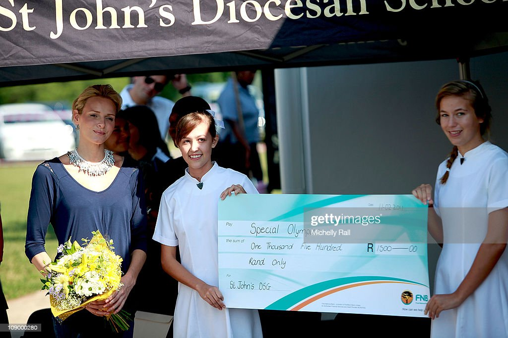 Charlene Wittstock, uture Princess of Monaco (L), is presented a cheque by pupils during the ribbon cutting ceremony for the opening of the school swimming pool during a charity fundraising breakfast in support of the Special Olympics at St John's Diocesan School on February 11, 2011 in Pietermaritzburg, South Africa.