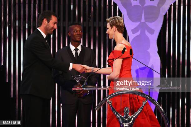 CharlenePrincess of Monaco hands the Laureus Sport For Good award to Tim Conibear from Waves For Change on stage during the 2017 Laureus World Sports...