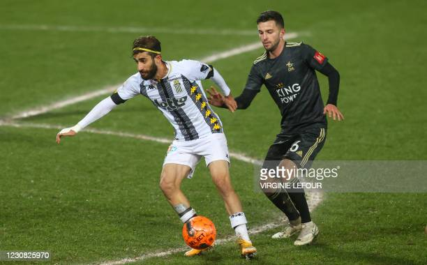 Charleroi's Ali Gholizadeh and OHL's Siebe Schrijvers fight for the ball during a soccer match between Sporting Charleroi and Oud-Heverlmee Leuven,...