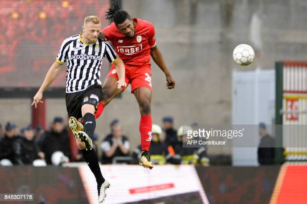 Charleroi's David Pollet vies with Standard's Christian Luyindama Nekadio during the Jupiler Pro League football match between Standard de Liege and...