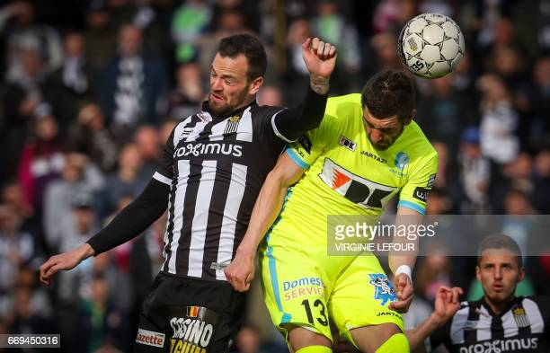 Charleroi's Dorian Dessoleil vies for the ball with Gent's Stefan Mitrovic during the Jupiler Pro League football match between Sporting Charleroi...