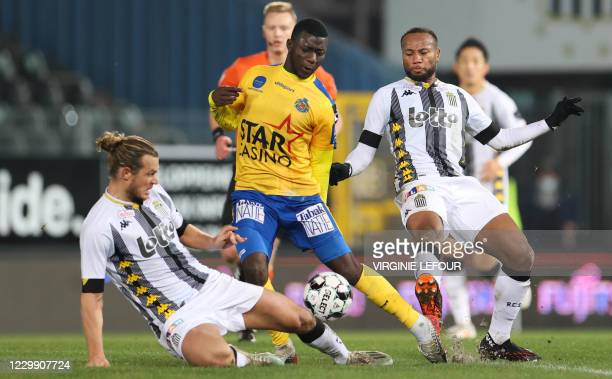 Charleroi's Guillaume Gillet, Waasland-Beveren's Aboubakary Koita and Charleroi's Marco Ilaimaharitra fight for the ball during a soccer match...