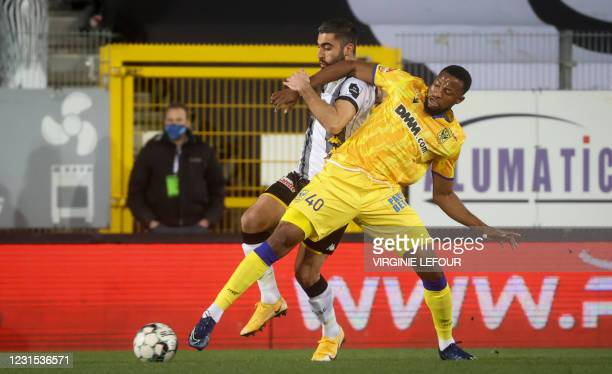 Charleroi's Kaveh Rezaei and STVV's Junior Udene Pius fight for the ball during a soccer match between Sporting Charleroi and Sint-Truiden VV, Friday...