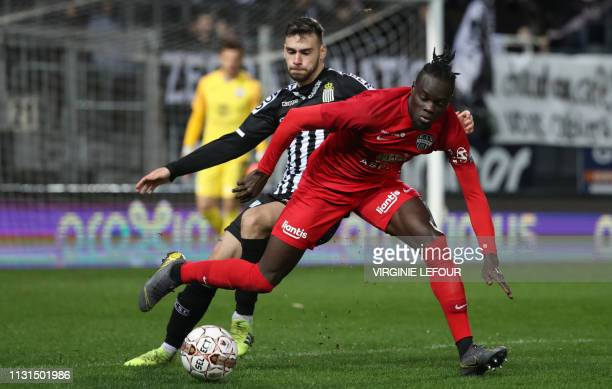 Charleroi's Massimo Bruno and Eupen's Mamadou Fall fight for the ball during a soccer match between Sporting Charleroi and KAS Eupen Sunday 17 March...