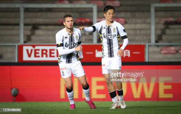 Charleroi's Steeven Willems and Charleroi's Ryota Morioka celebrate during a soccer match between KV Mechelen and Sporting Charleroi, Friday 06...