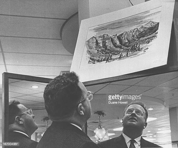 NOV 14 1962 Charles A Johnson looks over his painting The landscape painted near Durango Colo is one of about 60 on display at GanoDowns Cherry Greek...