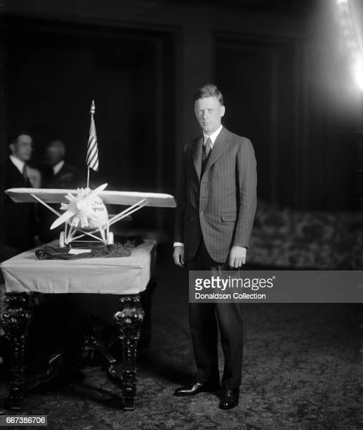 Charles A. Lindbergh, with plane model in circa 1925.