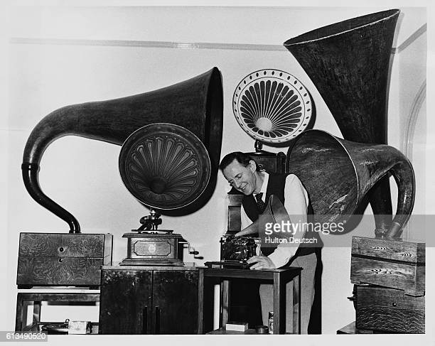 Charles Aldous a collector of early gramophones with some of the rare pieces in his collection which fill a whole room of his Eastbourne home