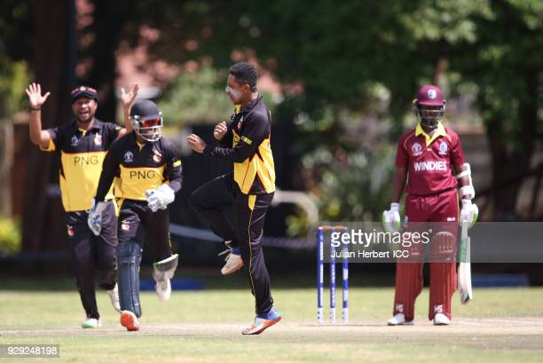 Charles Amini of Papua New Guinea celebrates the wicket of Jason Mohammed of The West Indies hits out during The Cricket World Cup Qualifier between...