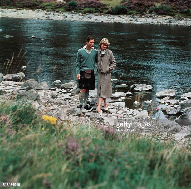 Charles and Diana, Prince and Princess of Wales, by the river at Balmoral after their honeymoon.