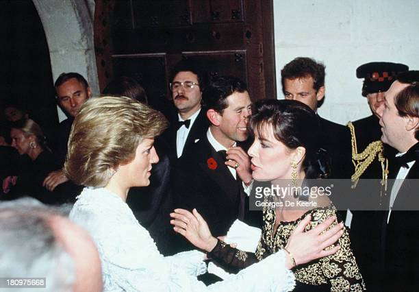 Charles and Diana Prince and Princess of Wales greet Princess Caroline of Monaco on a dinner at the Chateau de Chambord during their official visit...
