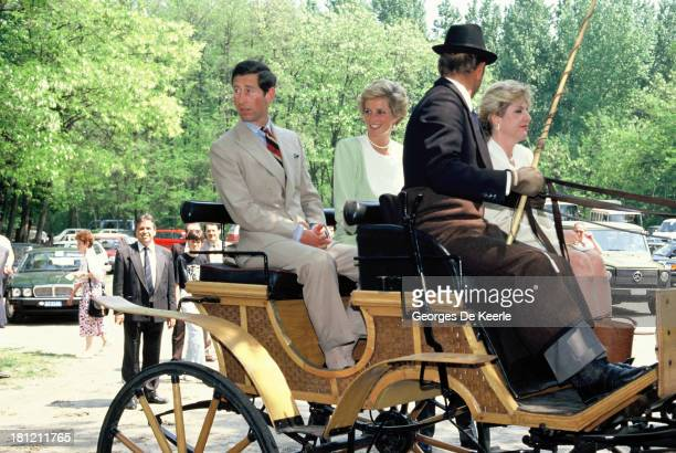 Charles and Diana Prince and Princess of Wales in an open carriage during their official visit to Hungary on May 9 1990 in Budapest Hungary