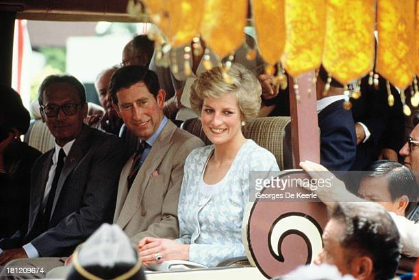 Charles and Diana Prince and Princess of Wales smile to the crowd during their official visit to Indonesia on November 6 1989 in Jakarta Indonesia